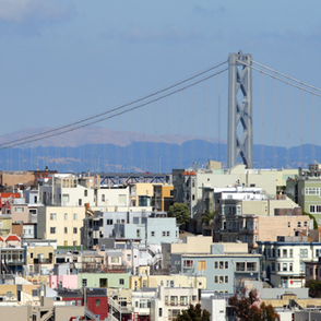 Neighborhood in San Francisco with the Bay Bridge int the background