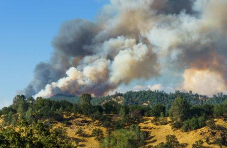 Plane Approaches Fire Burning On Ridge